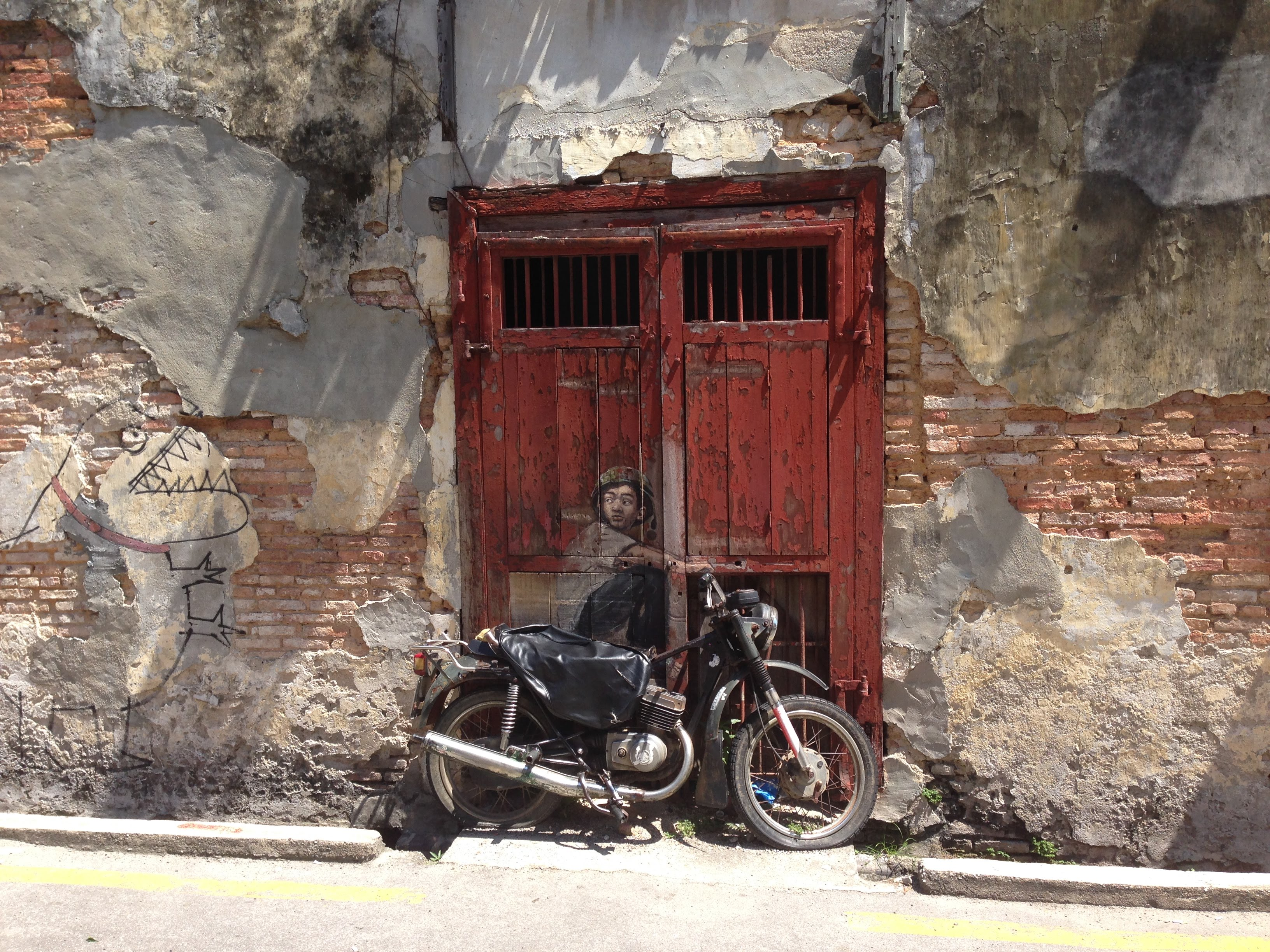 Boy motorbike George Town Penang Malaysia street art mural