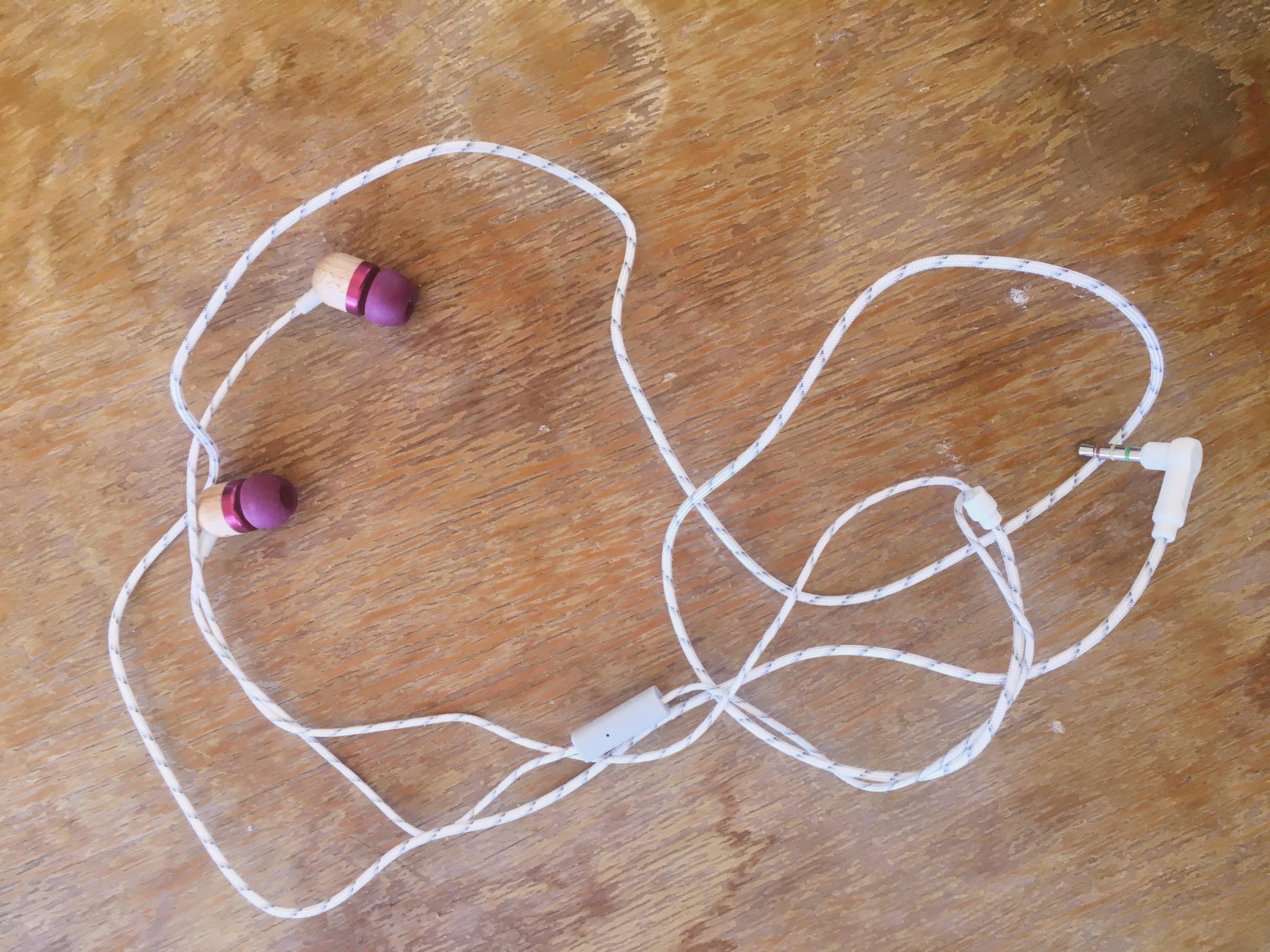 head phones ear plugs travel essentials