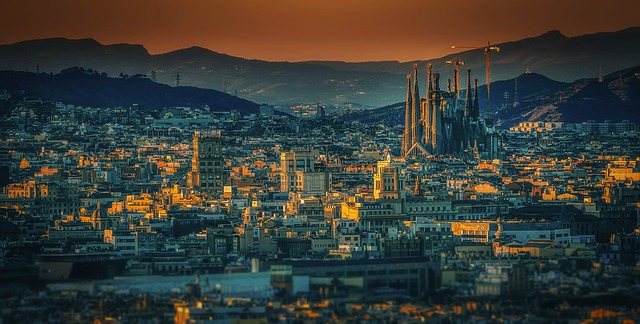 sunset view Barcelona Spain city mountains montjuic