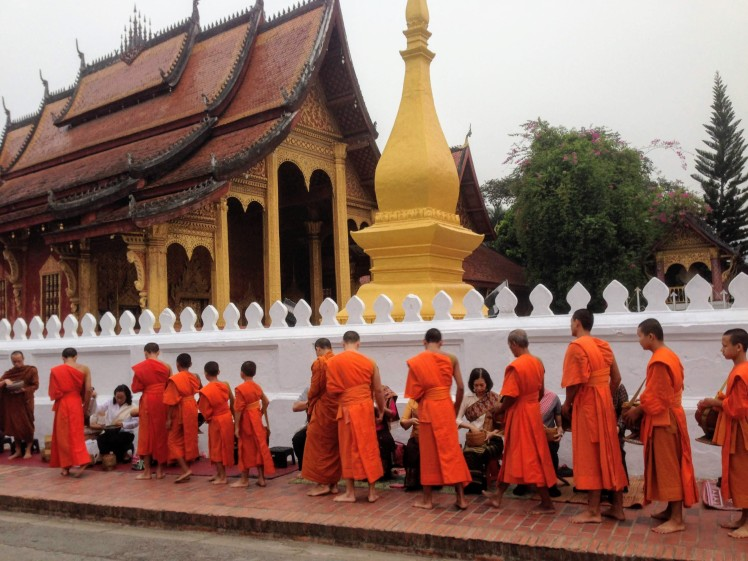 Luang Prabang Laos temple monks Buddhist alms giving ceremony