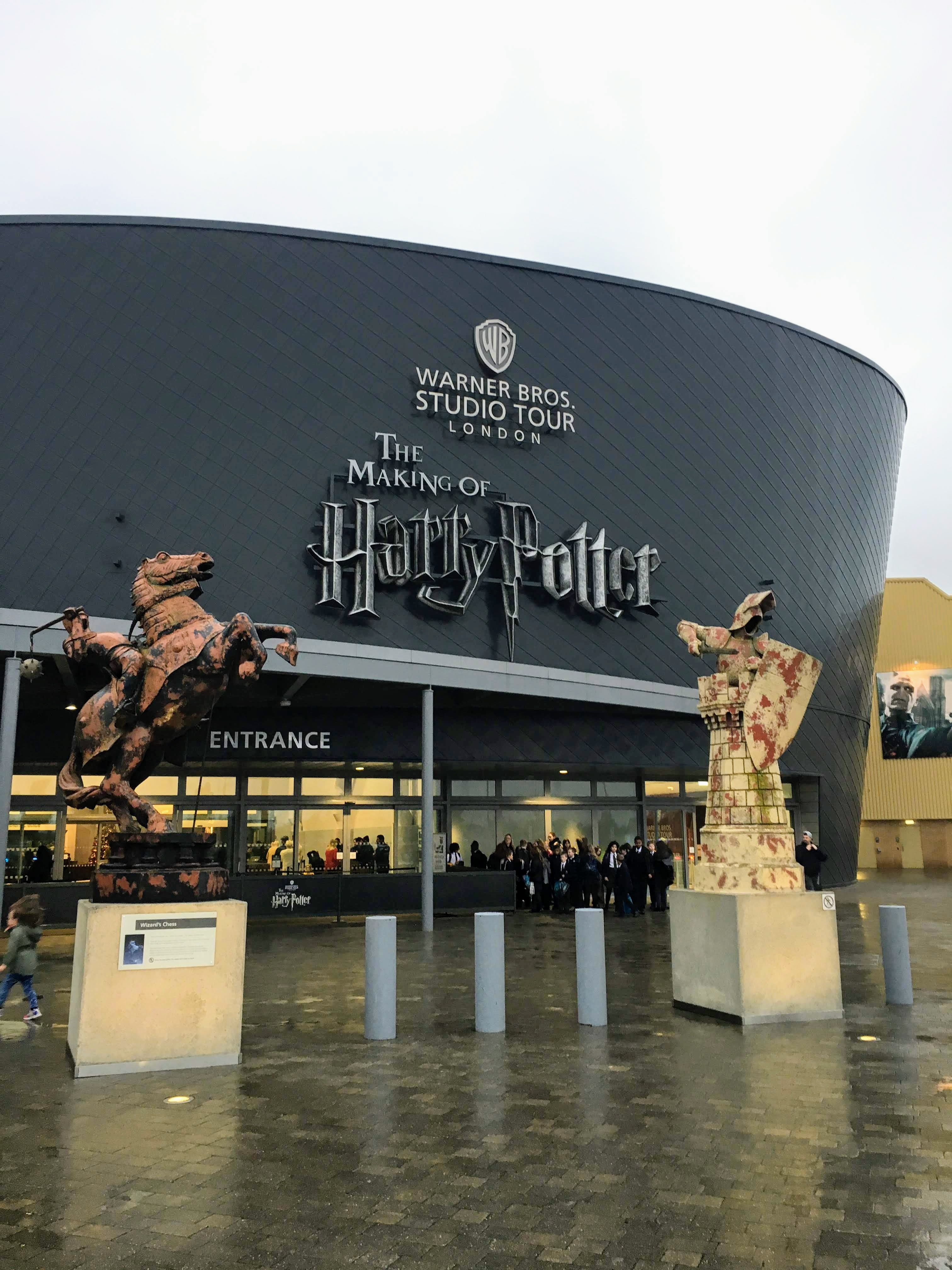 Outside of the Warner Bros Studio Tour London Making of Harry Potter, two wizard chess statues in front of the entrance
