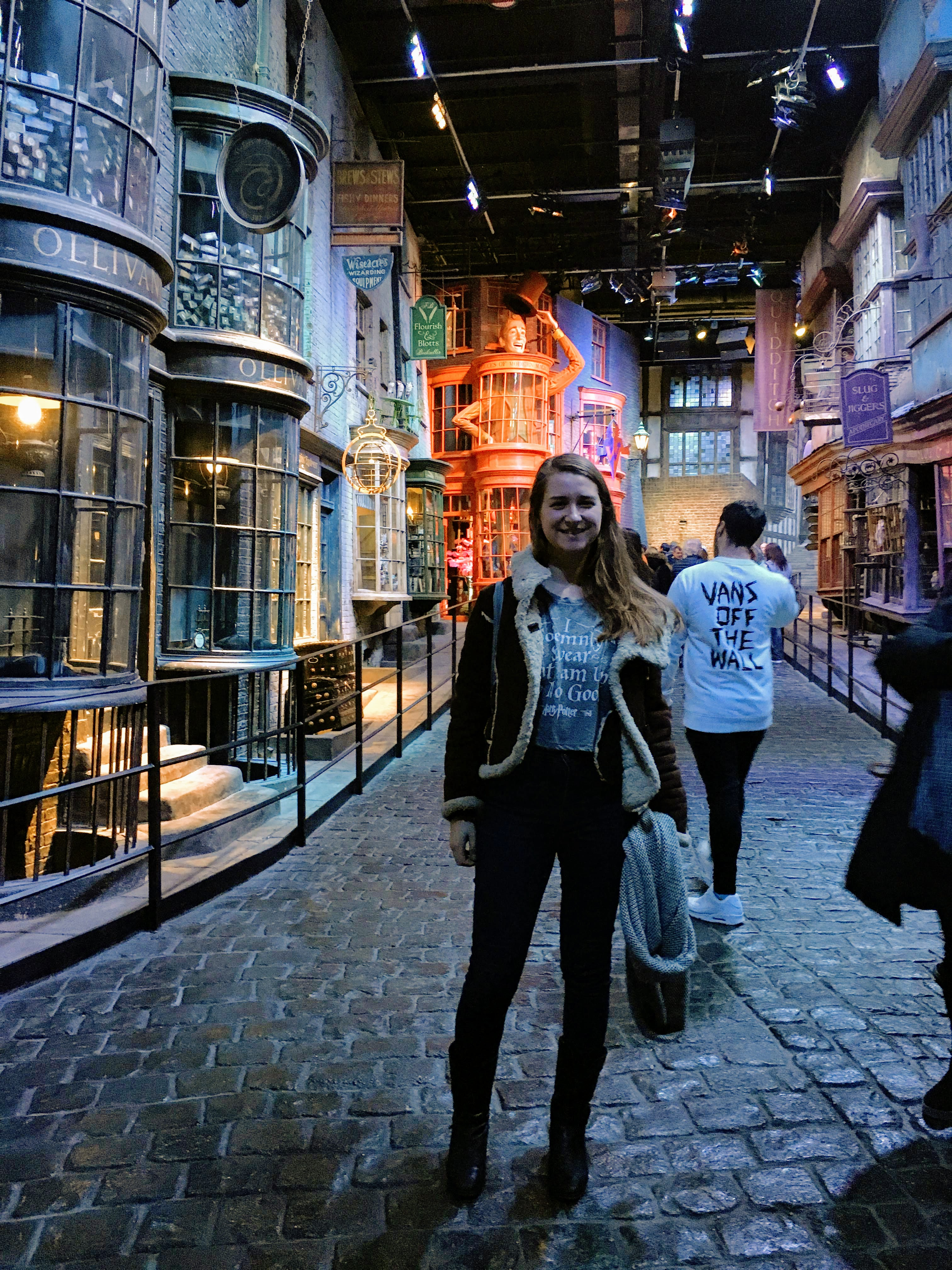 Woman standing in Diagon Alley movie set inside the Harry Potter Studio Tour London