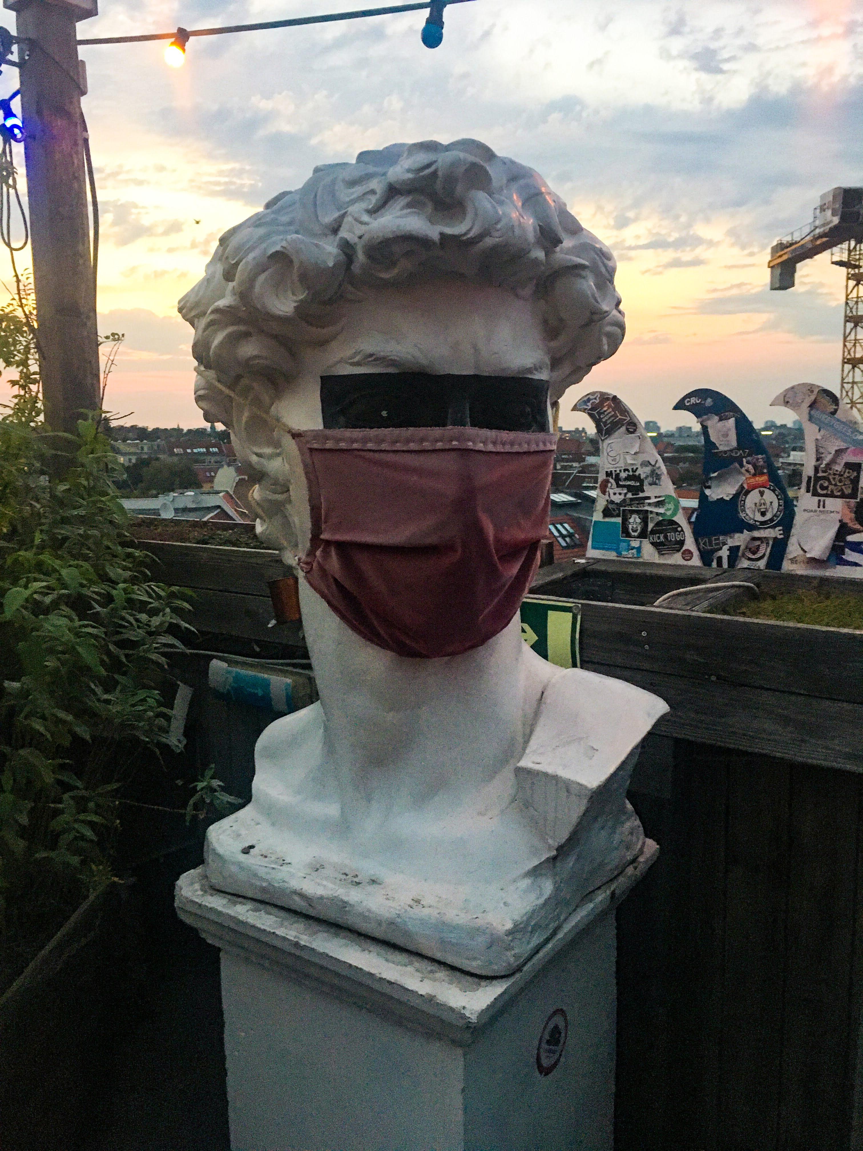 Klunkerkranig Berlin beer garden rooftop bar statue mask